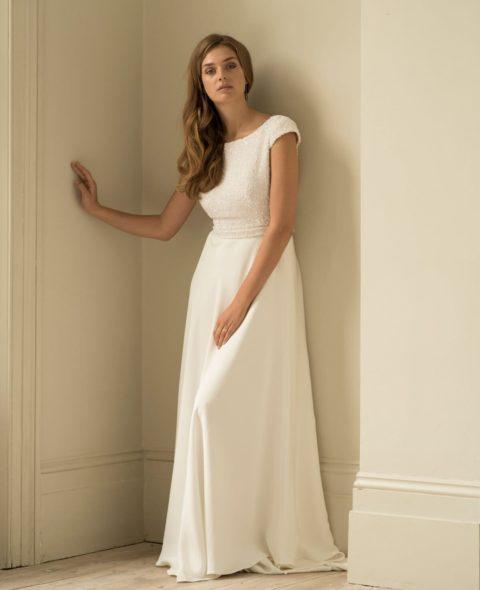 beaded wedding dress with cap sleeves silk skirt