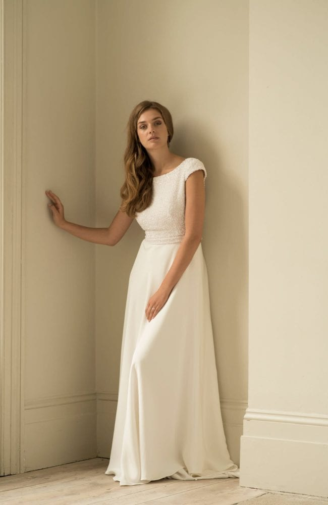beaded wedding dress with cap sleeves silk skirt
