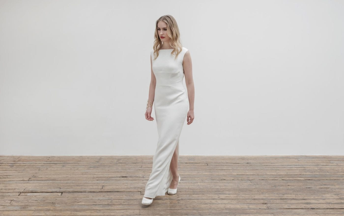 woman walking in high neck sleeveless structured bodice wedding dress