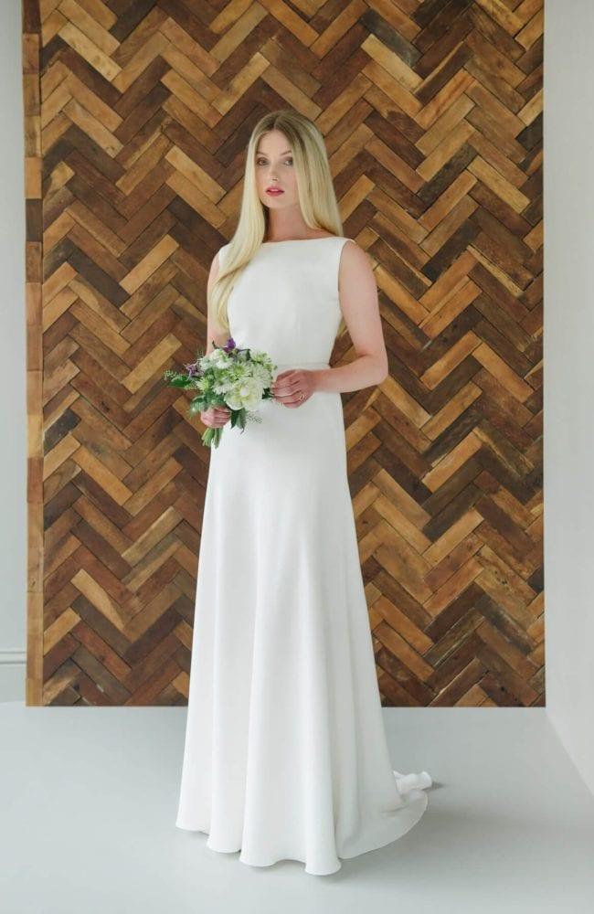 sleeveless boat neck romantic wedding dress