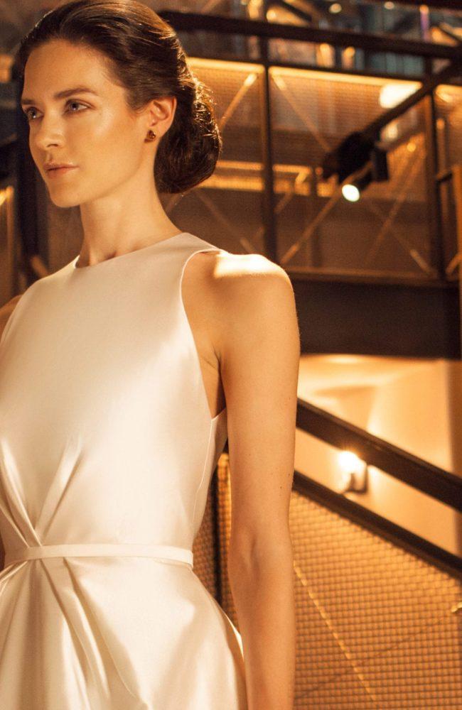 close up shot of high neck sleeveless princess wedding dress