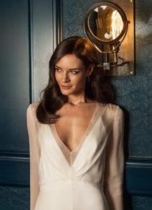 close up shot of v neck modern classic silk wedding dress with opaque overdress