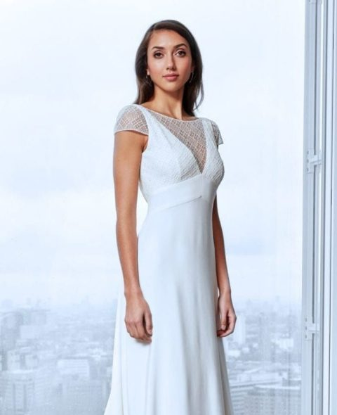 minimalistic lace wedding dress with cap sleeves