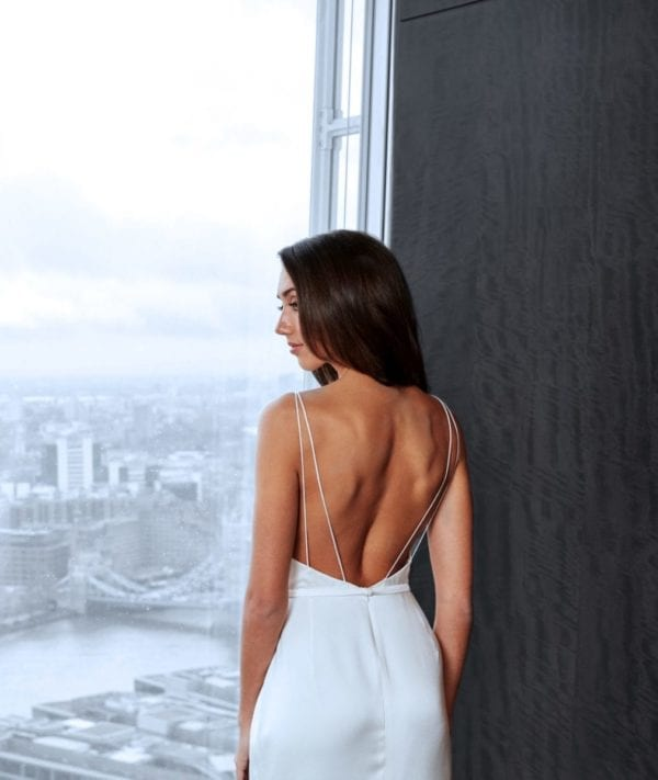 spaghetti strap wedding dress with fitted skirt and low open back