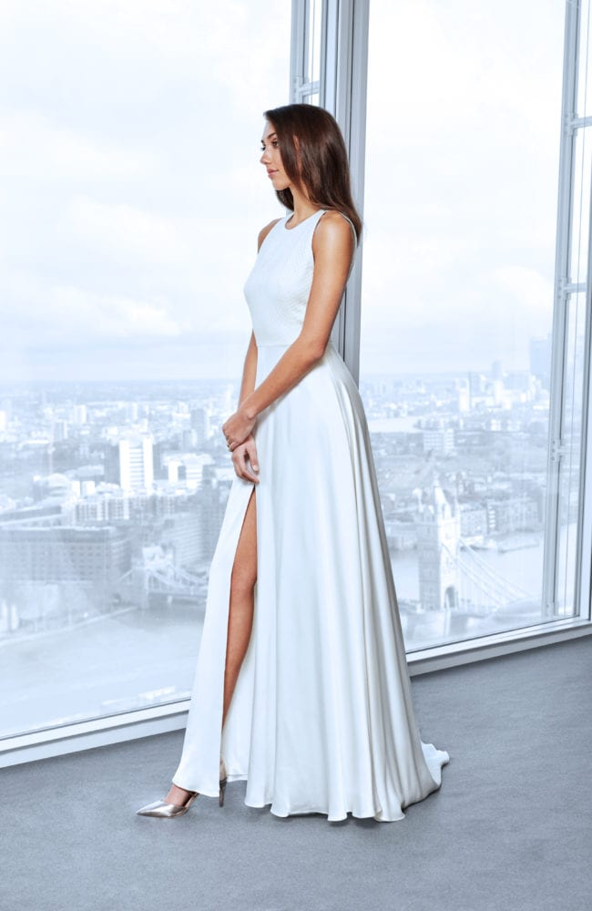 minimalistic high neck wedding dress with leg slit