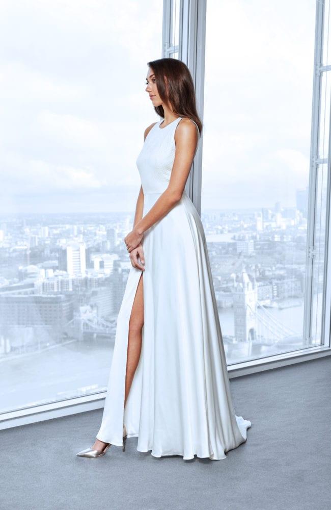 minimalistic halter neck wedding dress with leg slit