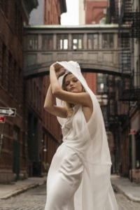simple v neck wedding dress with overlay with opaque overdress