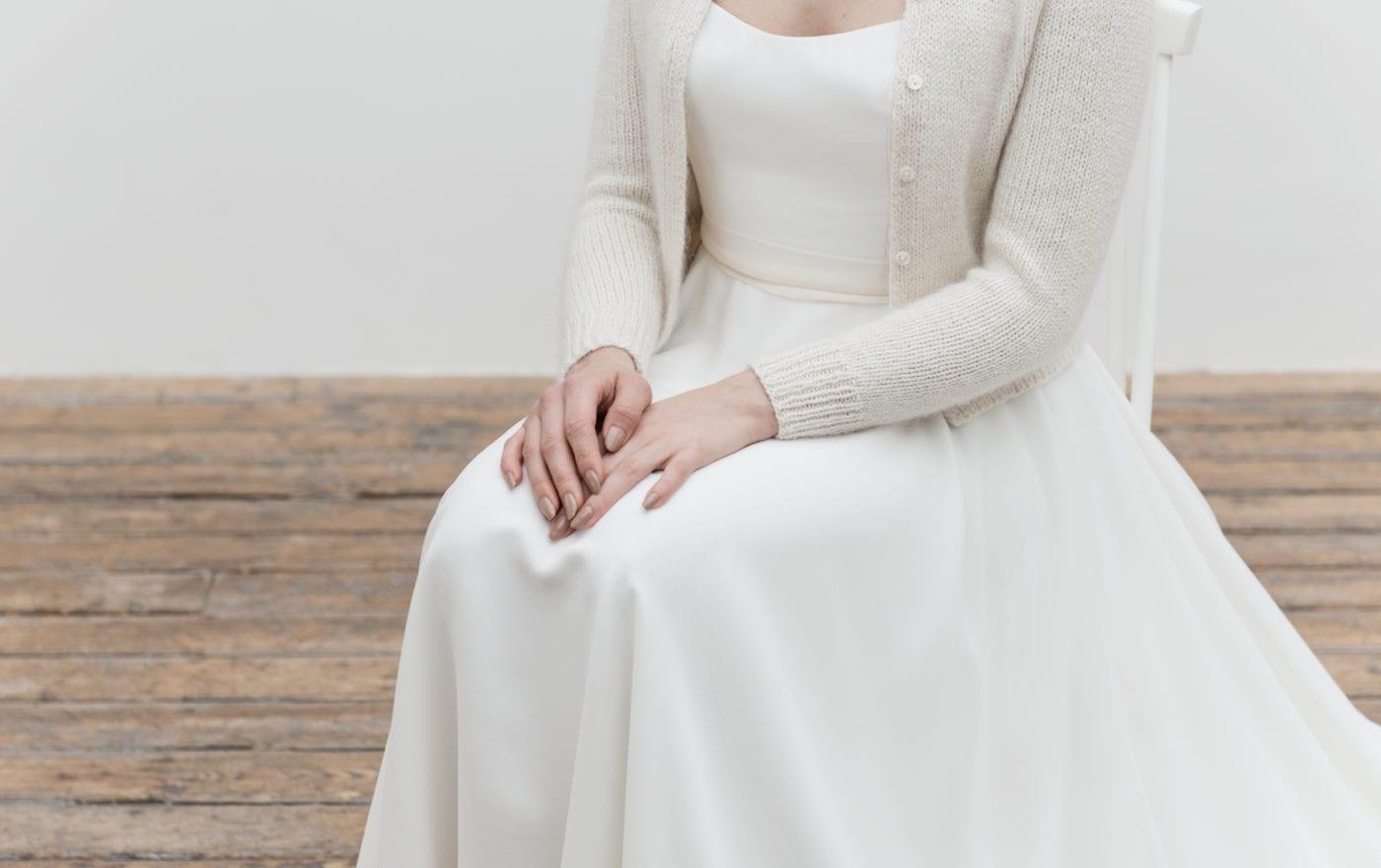 minimalistic strapless wedding dress with bridal cardigan