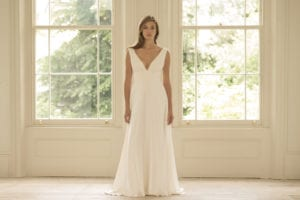 woman wearing minimal wedding dress with bridal overskirt