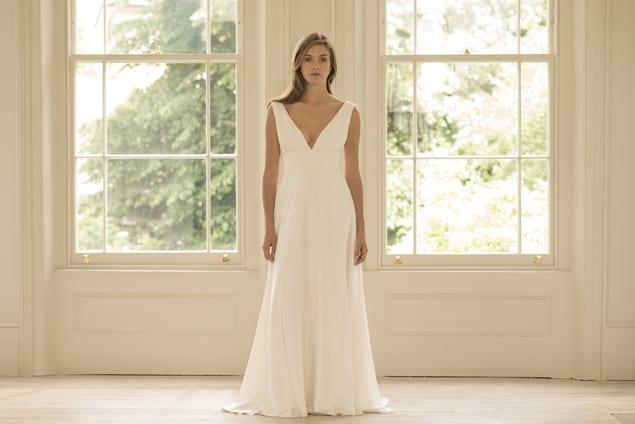 woman wearing minimal wedding dress with bridal overskirt