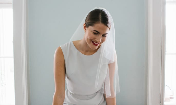 woman wearing simple wedding dress and veil