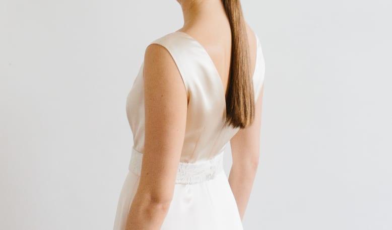 woman wearing silk ivory wedding dress with beaded bridal belt