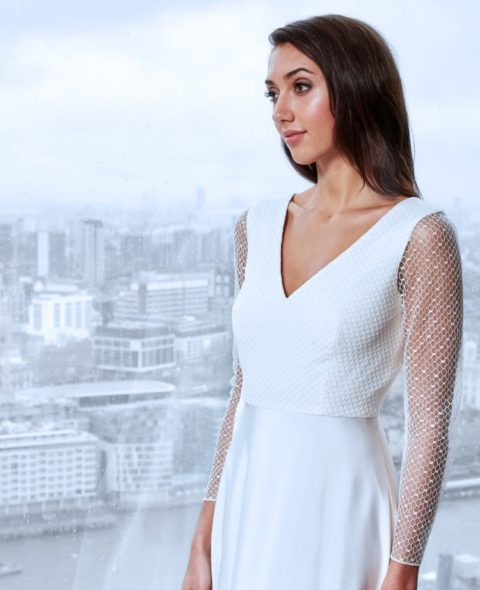 V-neck lace wedding dress with long sleeves