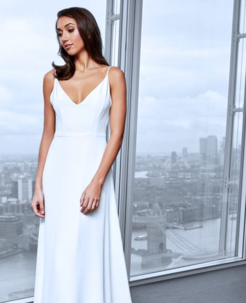 v-neck strappy wedding dress with soft a-line skirt and lace back