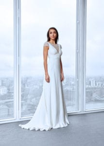 lace wedding dress with cap sleeves and low back