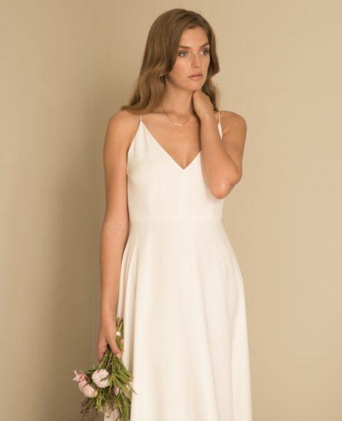 strappy spaghetti strap wedding dress with a-line skirt