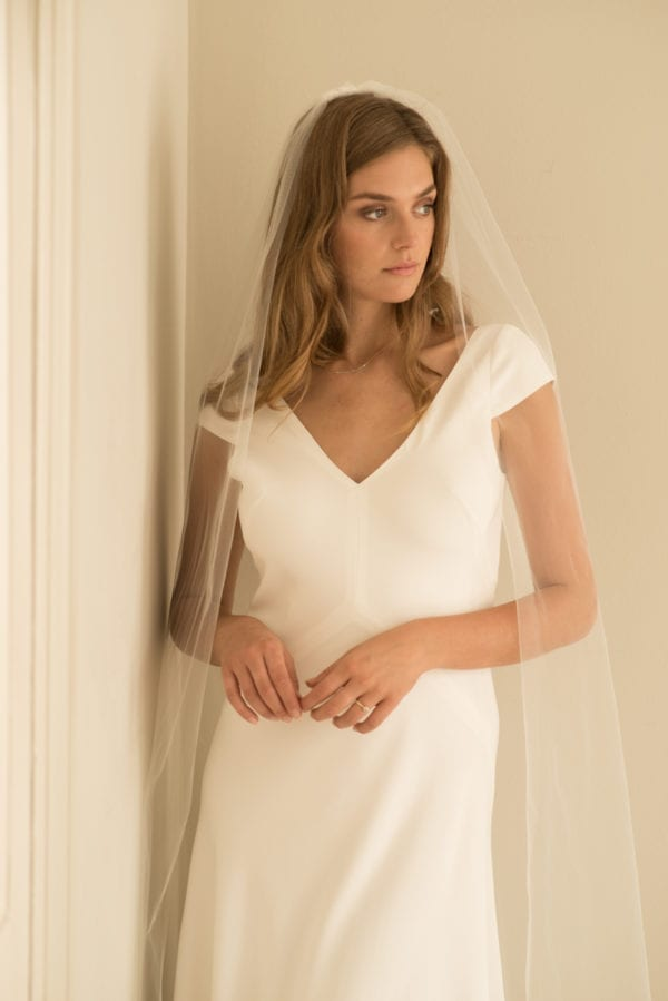v-neck bias cut wedding dress with cap sleeves and low back