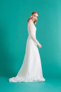 white wedding dress with sheer overlay and long sleeves