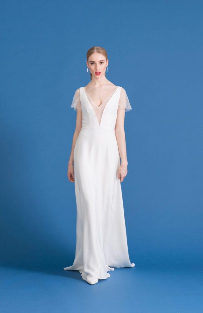 deep v neck wedding dress with sheer overlay and cap sleeve
