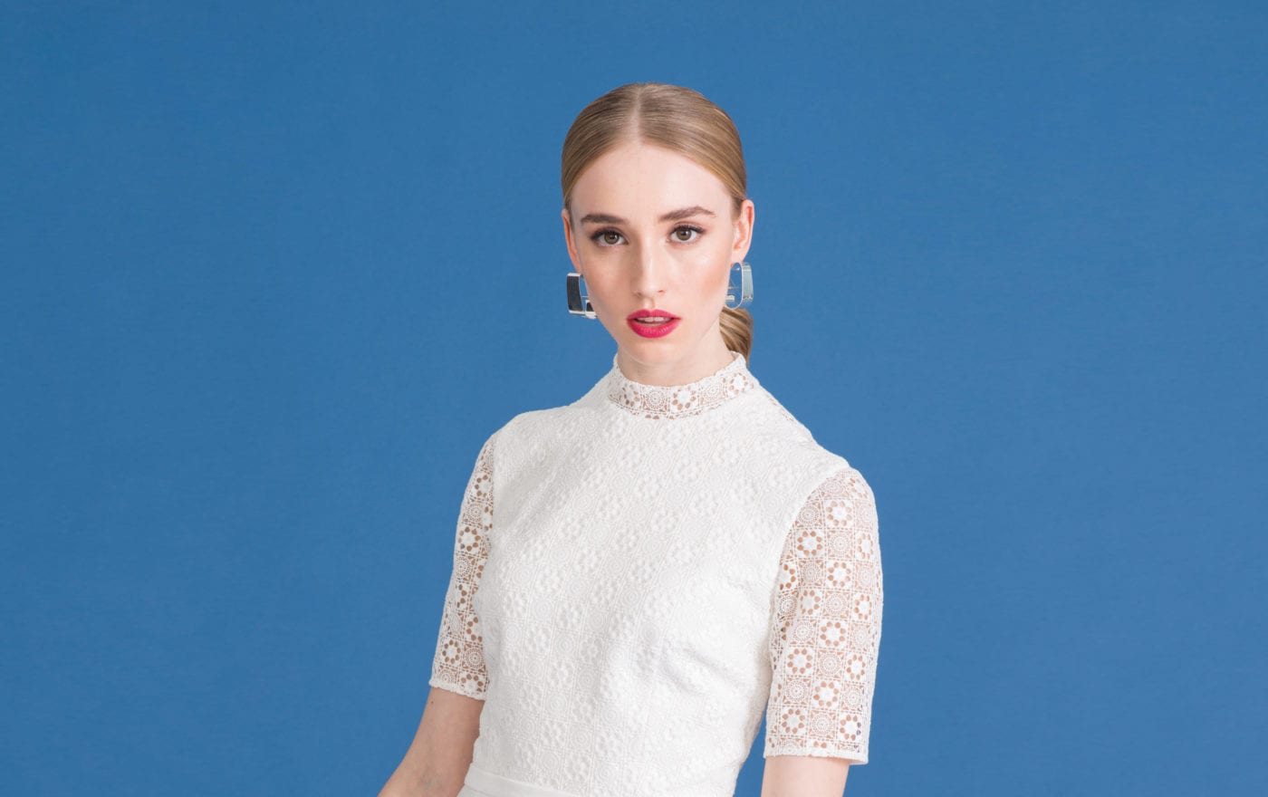 close up of woman wearing retro lace bridal top