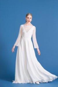 sleeveless wedding dress with deep v neck and sheer overdress