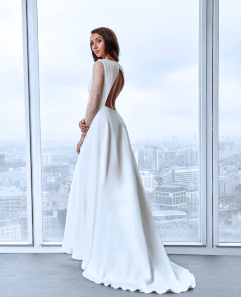 Wedding dress with long lace sleeves and open back