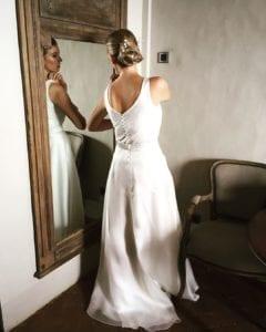 Bride trying on modern wedding dress