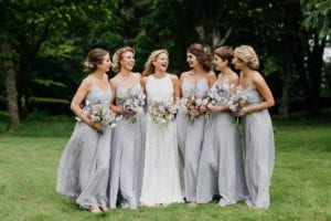 bride in white bridesmaids in lilac dresses