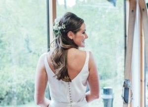 bride wearing low back silk wedding dress