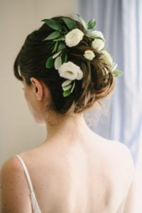 bride hair updo with greenery