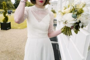 bride wearing silk wedding dress with lace bridal top