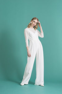 model wearing bridal jumpsuit with long sleeve bridal top