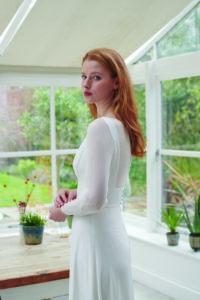 sheer sleeved wedding dress