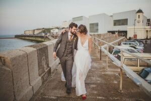 strappy minimal wedding dress with bridal overskirt