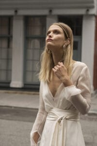wedding dress with sheer long sleeves and v-neck