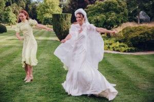 modern bridal cape and simple silk wedding dress
