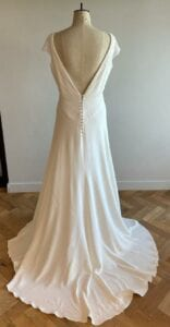 high neck lace wedding dress with cap sleeves and a-line skirt